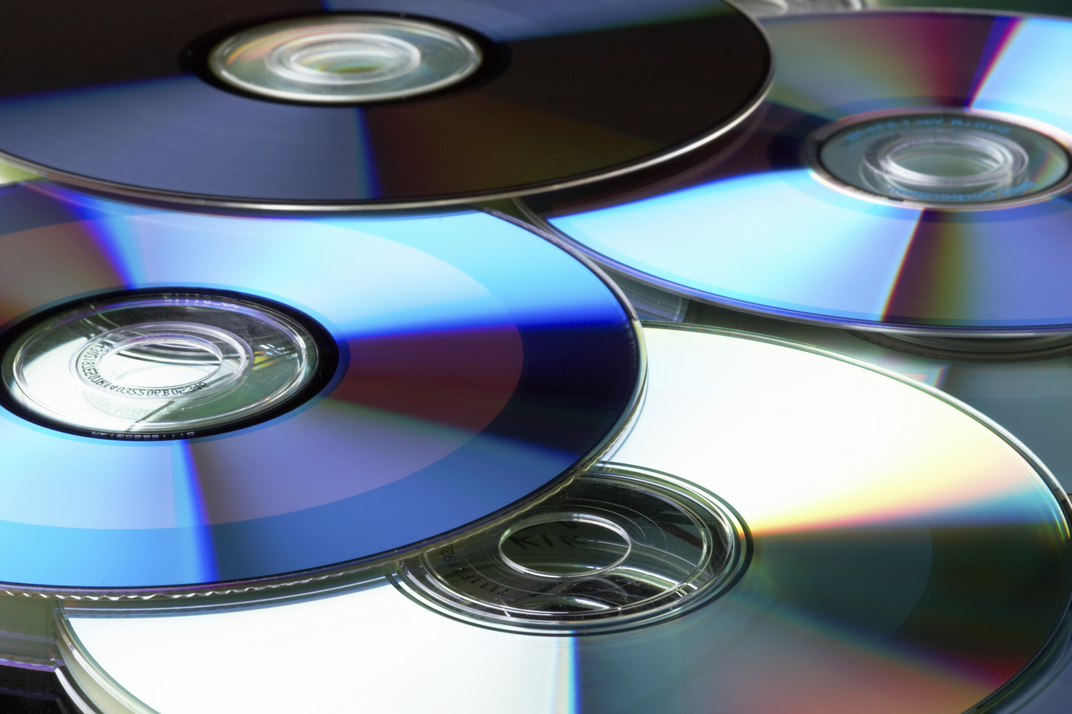 Many colorful DVD lying upon each other - landscape format