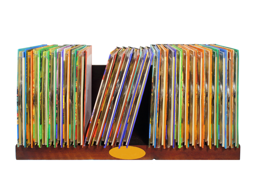 wooden shelf with colorful cd and dvd disks isolated on white background