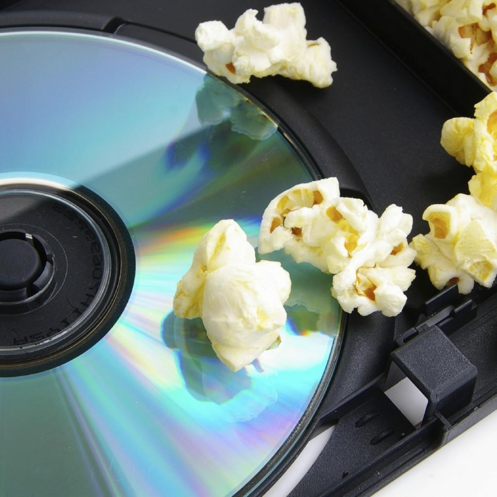 DVD or CD  and popcorn  closeup